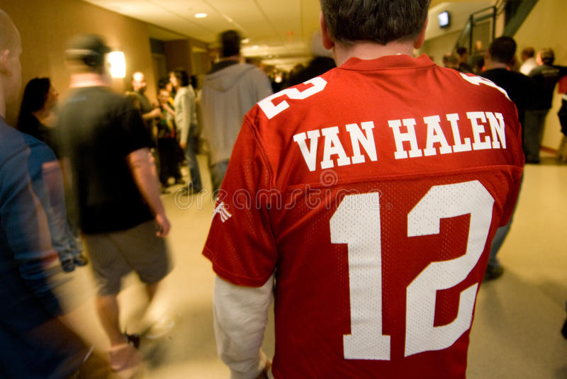 Van Halen Fan. A fan in a Van Halen '12 tour T-shirt walks the halls of the Verizon Wireless Arena in Manchester, New Hampshire, March 13, 2012 royalty free stock photos