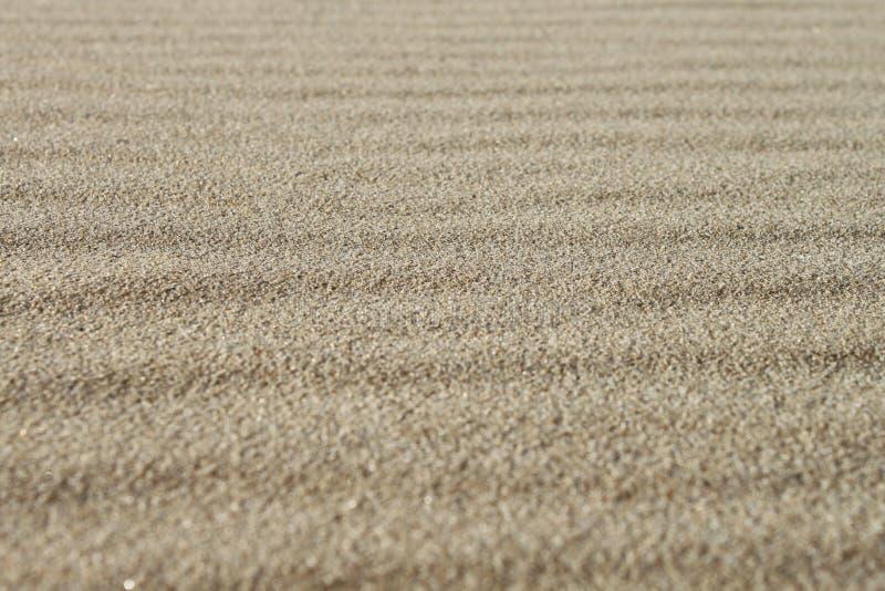 Van het achtergrond zand textuur stock afbeeldingen