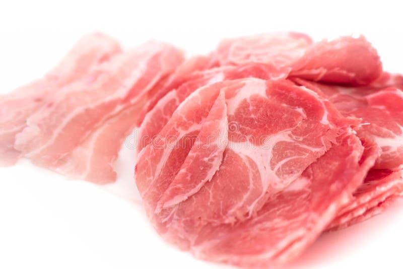 Van het bron varkensvleesvlees van proteïne dunne plak op wit stock afbeeldingen