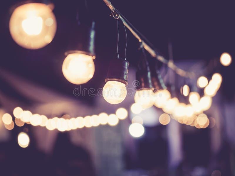 Van het de Gebeurtenisfestival van de lichtendecoratie Uitstekende achtergrond van Hipster de openlucht stock fotografie