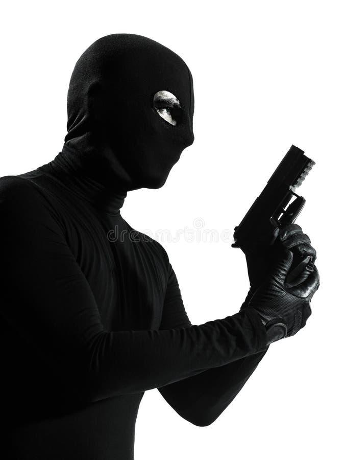 Van het de holdingskanon van de dief misdadig terrorist het portretsilhouet stock foto