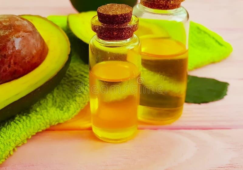 Van het de versheidsuittreksel van de avocado sappige olie houten de vitaminegezondheid stock afbeeldingen