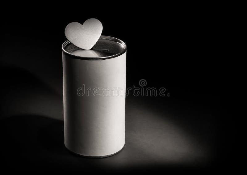Van het schenkingsdoos en hart vorm in dark stock foto's