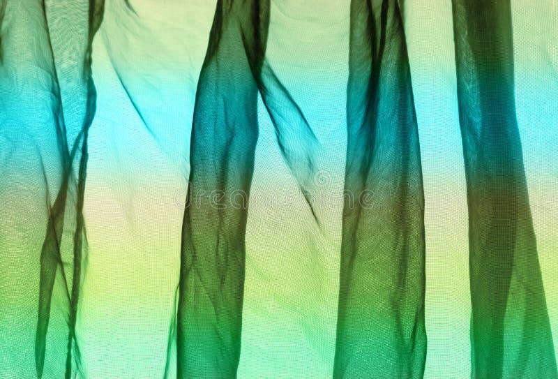 Van het voilegordijn groenachtig blauwe geel als achtergrond stock afbeeldingen