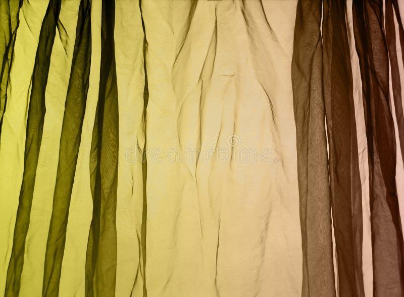 Van het voilegordijn groene bruin als achtergrond stock fotografie