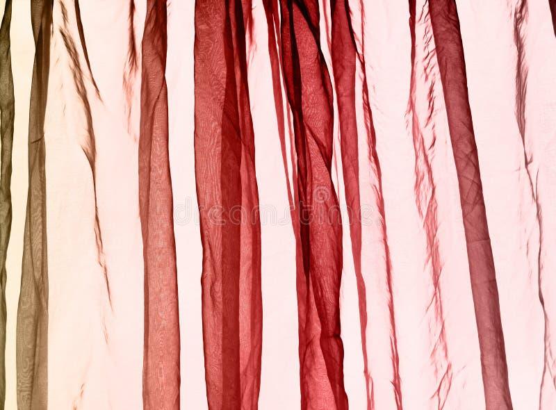 Van het voilegordijn rode kleuren als achtergrond royalty-vrije stock foto's
