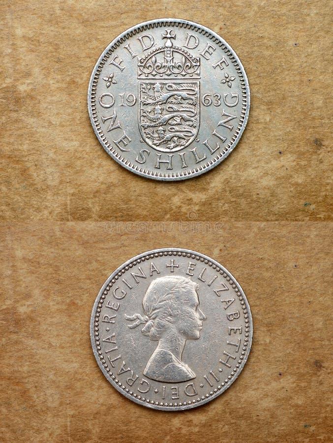 Van reeks: muntstukken van wereld. Engeland. ÉÉN SHILLING. royalty-vrije stock afbeeldingen