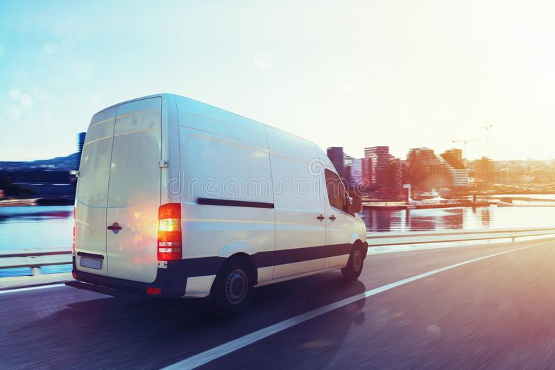 Van run fast on the highway to deliver. 3D Rendering. Moving van on the highway with city background. 3D Rendering stock illustration