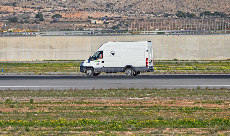 A Van On The Runway. An airport workers van races down the runway at Alicante Airport royalty free stock photo