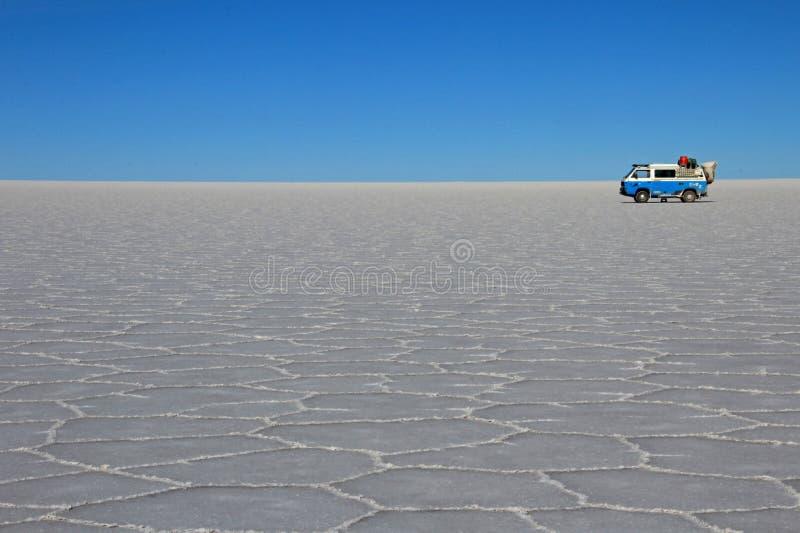 Van on Salar de Uyuni, salt lake, Bolivia. Van on Salar de Uyuni, salt lake, is largest salt flat in the world, altiplano, Bolivia, South America royalty free stock images