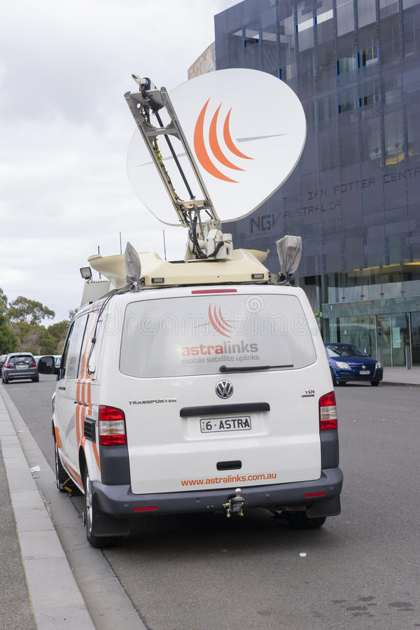 Van with satellite dish. Melbourne, Australia - July 2, 2016: Custom-made van with satellite dish parked on the street to cover news and sporting events in stock photography