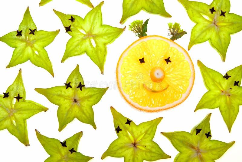 Van Starfruit (carambola) de plakken met oranje gezicht stock foto's