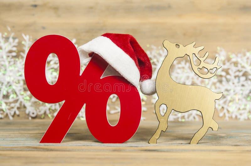 van tekenpercenten en Kerstmis decoratie op houten achtergrond stock afbeelding