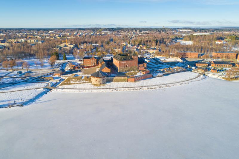 Vanajavesi  lake and the ancient fortress off Hameenlinna, March morning aerial survey. Finland royalty free stock photos