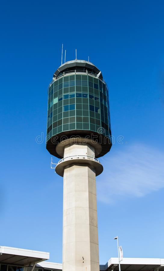 Vancouver Aircraft Control Tower. The distinctive city of Vancouver modern aircraft control tower against a bright blue sky background guides visitors to this stock photos