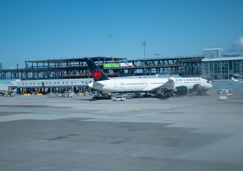 Vancouver airport and air canada airplane. Beautiful Vancouver airport and air canada airplane royalty free stock photo