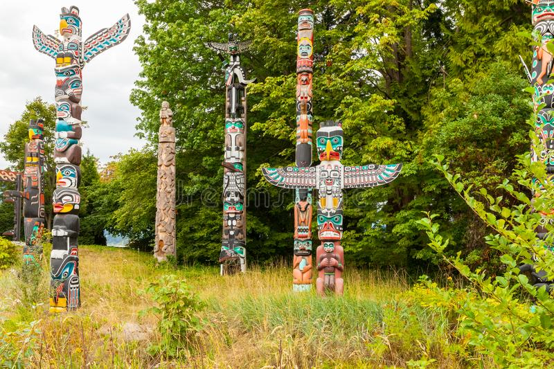Colorful indian totems at stanley clark park vancouver royalty free stock image