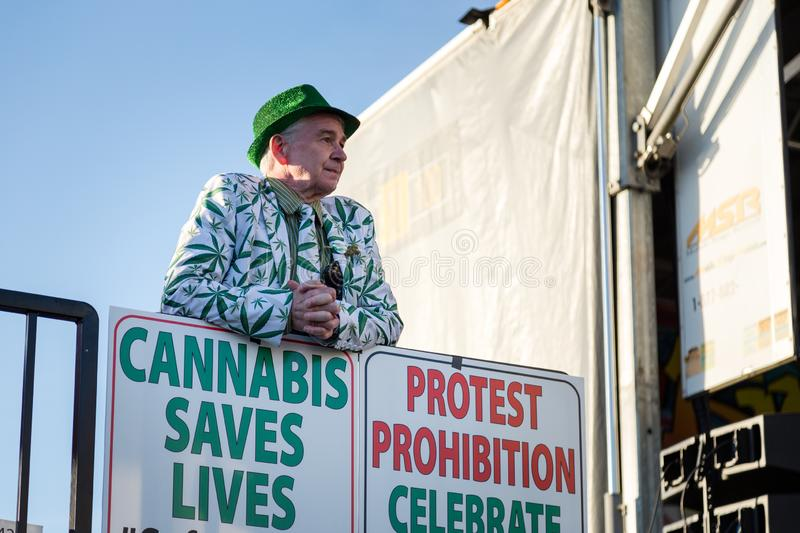 VANCOUVER, BC, CANADA - APR 20, 2019: A marijuana activist standing by a pro-marijuana sign at the 420 festival in stock images