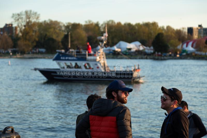 VANCOUVER, BC, CANADA - APR 20, 2019: A Vancouver Police boat patrolling the harbor at the 420 festival in Vancouver. stock photos