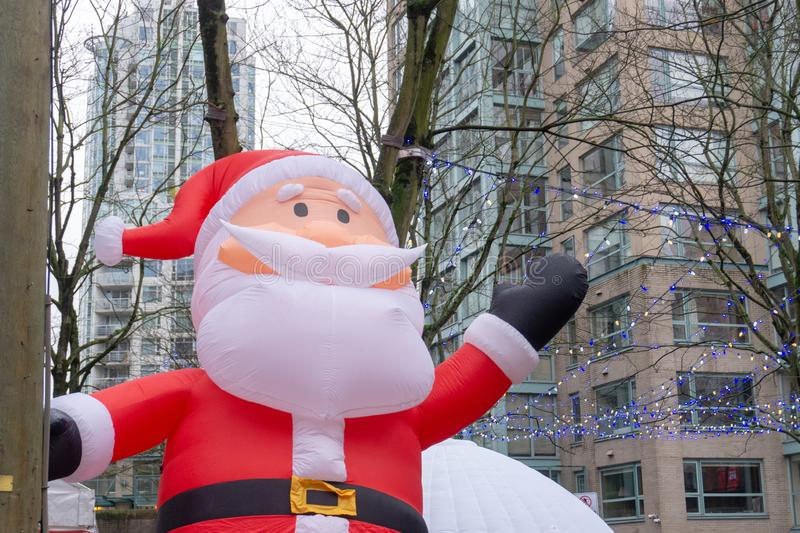 Vancouver, BC, Canada - 11/25/18: Giant, inflatable Santa Claus balloon, in downtown Vancouver at Yaletown CandyTown, a Christmas royalty free stock photography