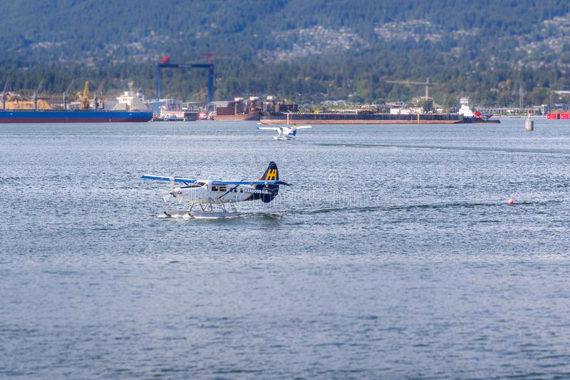 VANCOUVER, BC, CANADA - JUNE 06, 2016: Harbour Air Dehavilland Otters in Vancouver`s Coal Harbour. VANCOUVER, BC, CANADA - JUNE 06, 2016: Harbour Air royalty free stock photo