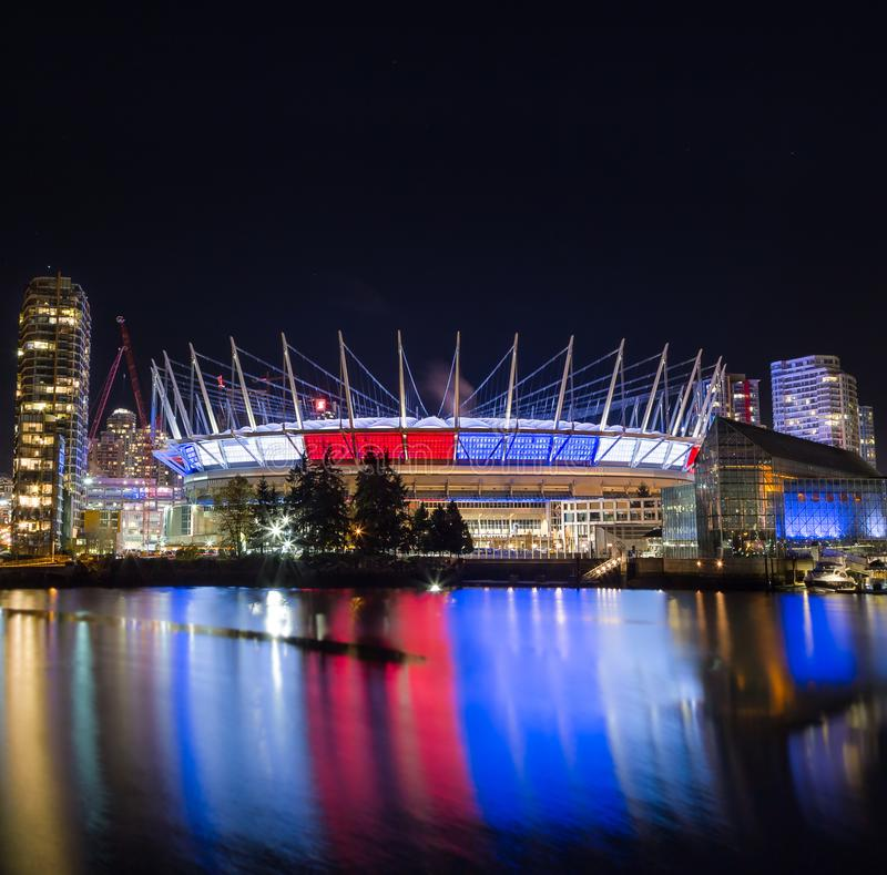 VANCOUVER, BC, CANADA - NOV 16,2015: BC Place, in False Creek, displaying the French tricolore as a show of support in royalty free stock photos