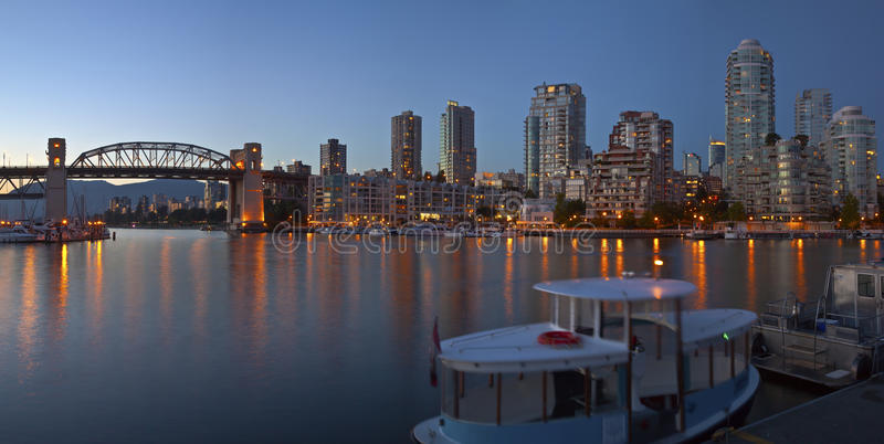 Vancouver BC skyline at False Creek at dusk. Vancouver BC skyline and the Burrard bridge at false Creek Canada stock image