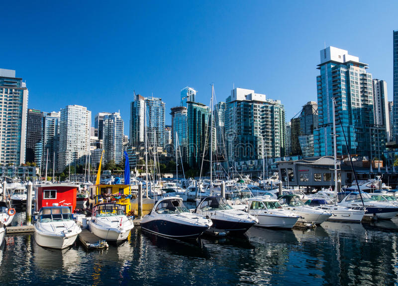 Vancouver boats and skyline. High rise buildings above the private boats moored in the harbor in Vancouver, British Columbia Canada royalty free stock photos