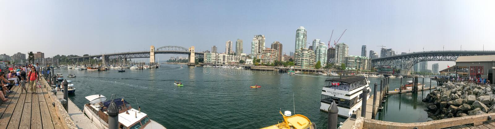 VANCOUVER, CANADA - AUGUST 10, 2017: Panoramic view of Granville Island skyline. Vancouver attracts 20 million people annually royalty free stock photography