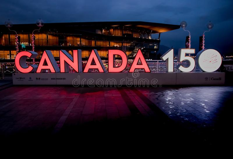 Vancouver, Canada - December, 2017: CANADA 150 years anniversary. Vancouver, Canada - December, 2017: `CANADA 150` anniversary celebration sign with illuminated royalty free stock photo