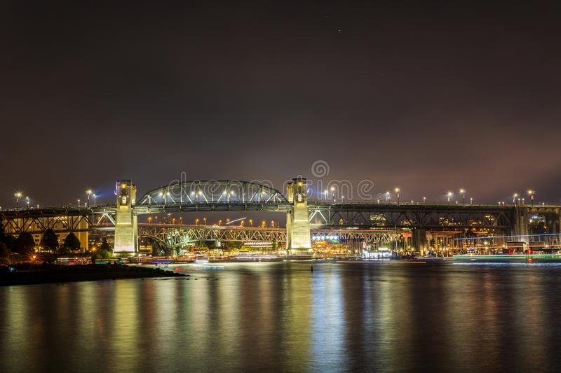 VANCOUVER, CANADA - JULY 31, 2019: view to Burrard bridge at night from Sunset Beach in downtown stock image