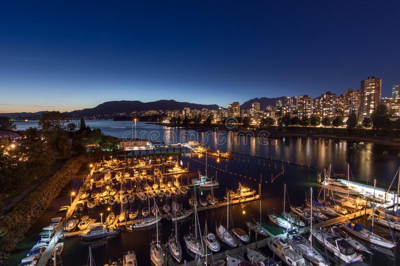 Vancouver, Canada - June 23, 2017: Boats in the Burrard Civic Marina. With Vancouver`s downtown in the background royalty free stock image