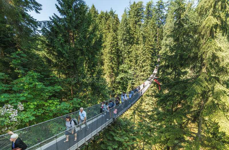 Vancouver, Canada - June 24, 2017: People crossing the famous Ca stock image