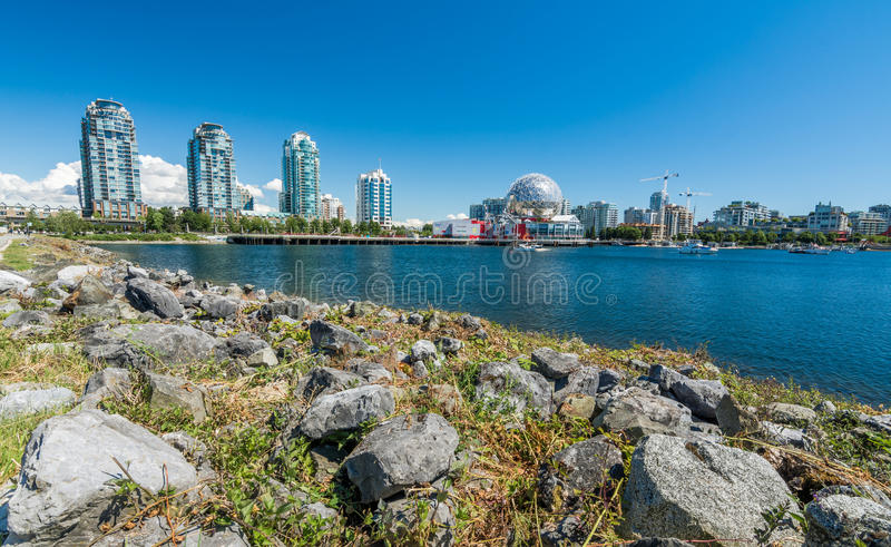 Vancouver, Canada - June 20, 2017: The world of science and olympic village at Flase creek on a sunny afternoon royalty free stock photos