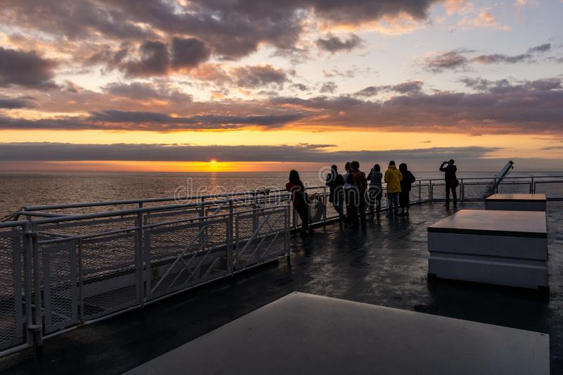 VANCOUVER, Canada - September 01, 2018: Passengers on Deck of a BC Ferries Vessel sunrise cruise to Vancouver Island.  royalty free stock photos