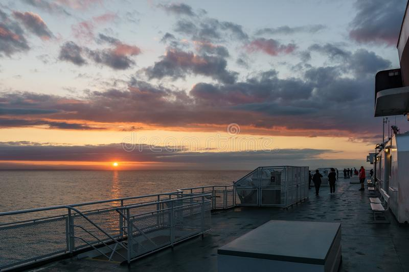 VANCOUVER, Canada - September 01, 2018: Passengers on Deck of a BC Ferries Vessel sunrise cruise to Vancouver Island.  royalty free stock photo