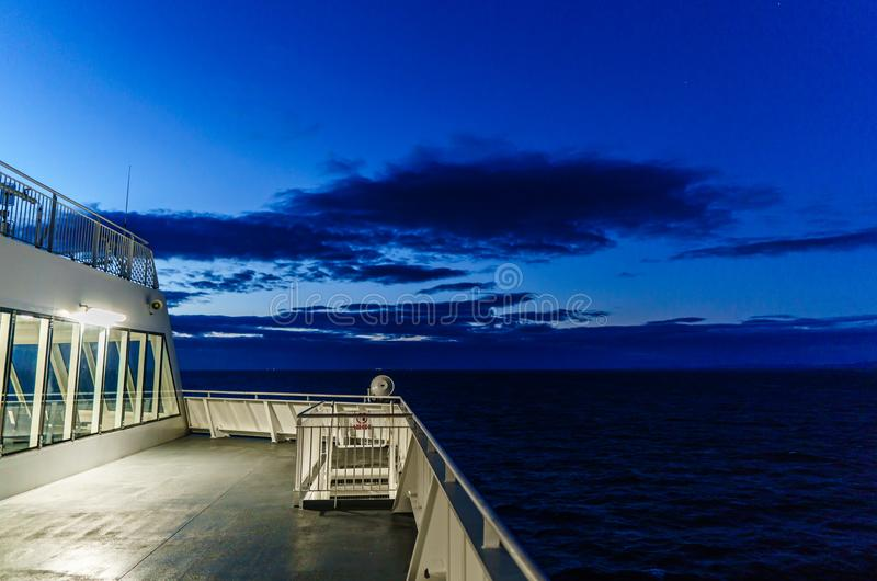 VANCOUVER, Canada - September 03, 2018: view from Passenger Deck of a BC Ferries Vessel sunrise cruise to Vancouver. Ferry ocean sea ship sky tourism travel royalty free stock image