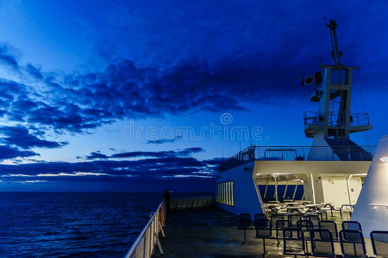 VANCOUVER, Canada - September 03, 2018: view from Passenger Deck of a BC Ferries Vessel sunrise cruise to Vancouver.  stock photo
