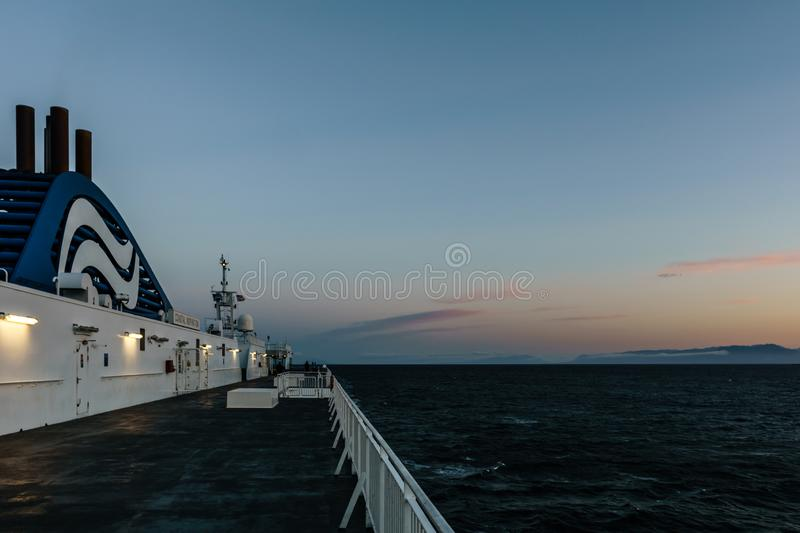 VANCOUVER, Canada - September 03, 2018: view from Passenger Deck of a BC Ferries Vessel sunrise cruise to Vancouver.  royalty free stock photos