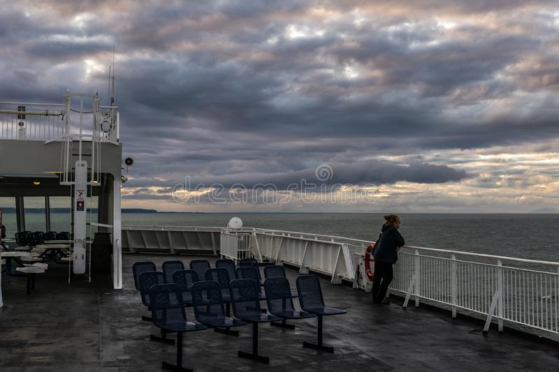 VANCOUVER, Canada - September 03, 2018: view from Passenger Deck of a BC Ferries Vessel sunrise cruise to Vancouver.  royalty free stock images