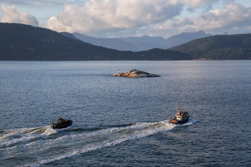 Vancouver Police on boats are traveling in Howe Sound stock images