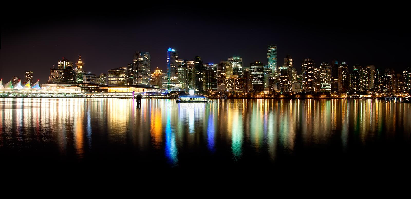 Vancouver Skyline at Night. Shot from Stanley Park on a summer night at 1030PM, a skyline night view of the beautiful city of Vancouver, British Columbia, Canada stock image