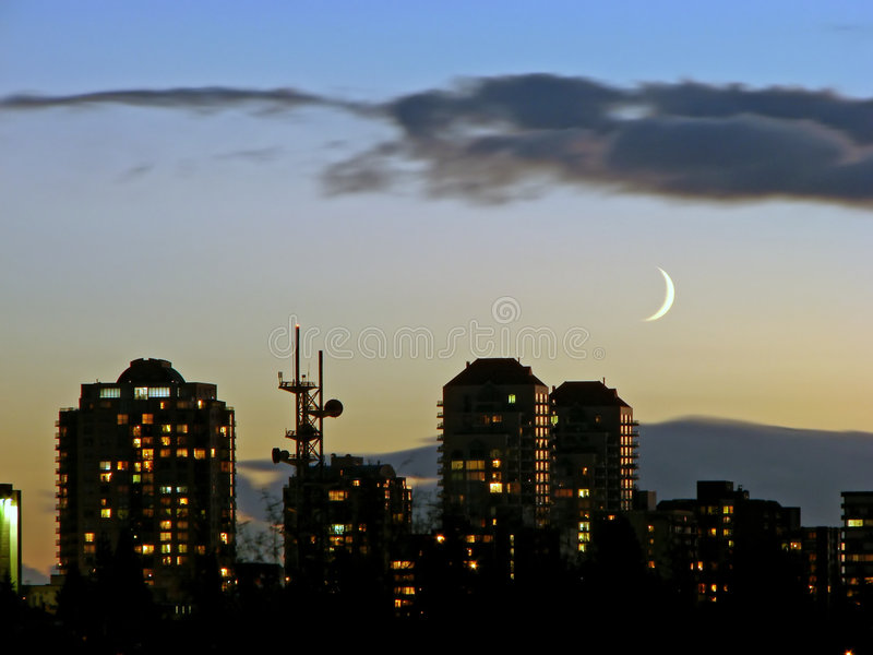 Vancouver sunset. A sunset shot taken in the Vancouver area, BC, Canada. It looked so pretty with that sliver of moon present. and the reflection on the royalty free stock images