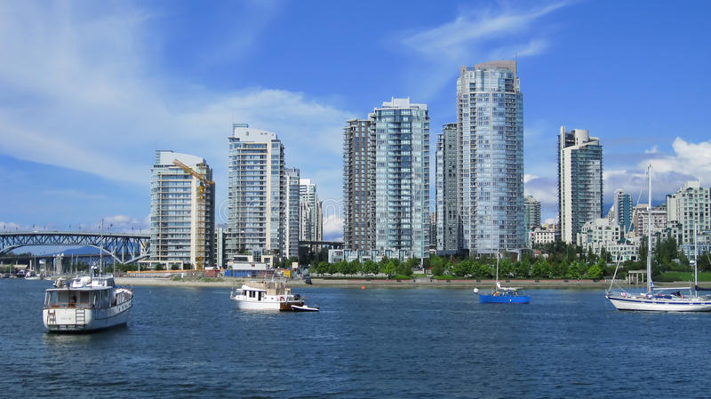 Vancouver waterfront marina on a blue summer day. With boats and apartments in the background royalty free stock images