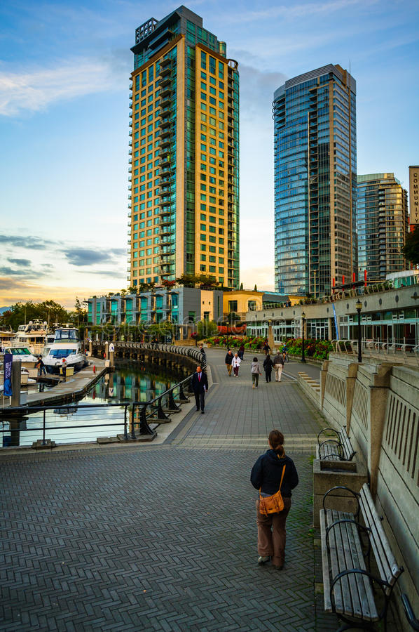 Vancouver Waterfront Pedestrain. People at Coal Harbor on the way to Waterfront in Vancouver Canada. Famous sidewalk where park visitors walk, bike, roll, and stock photo