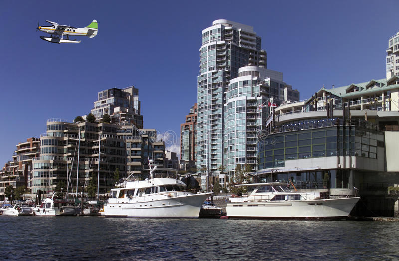 Vancouver - Yaletown - Canada. Floatplane flying low over False Creek, Graville Island and the Yaletown waterfront in the city of Vancouver in western Canada stock image