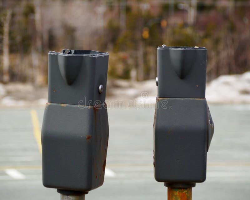 Vandaliserad parkeringsmeter royaltyfri bild