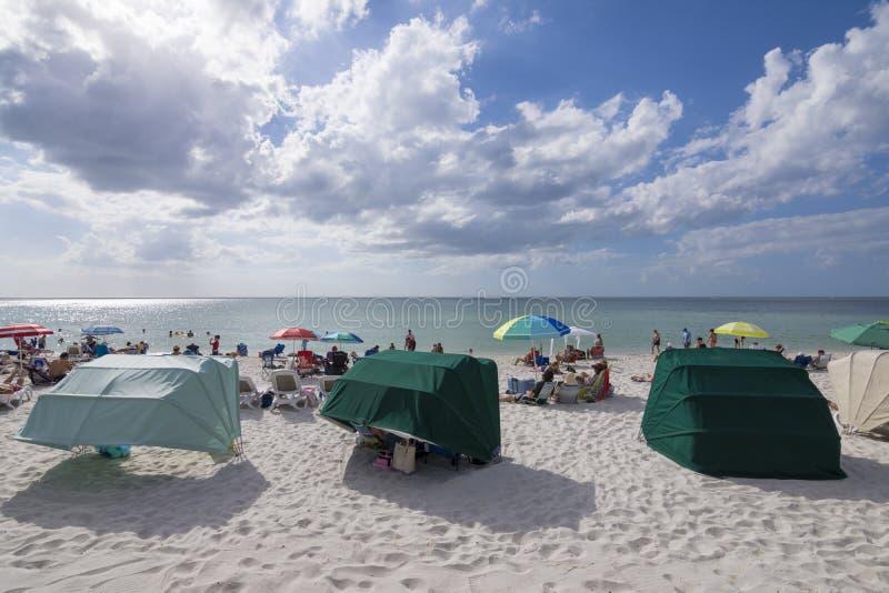 Vanderbilt Beach in Naples, Florida. NAPLES, FLORIDA, USA - NOVEMBER 6, 2016: The warm southern Florida climate makes Vanderbilt Beach a popular destination year royalty free stock images