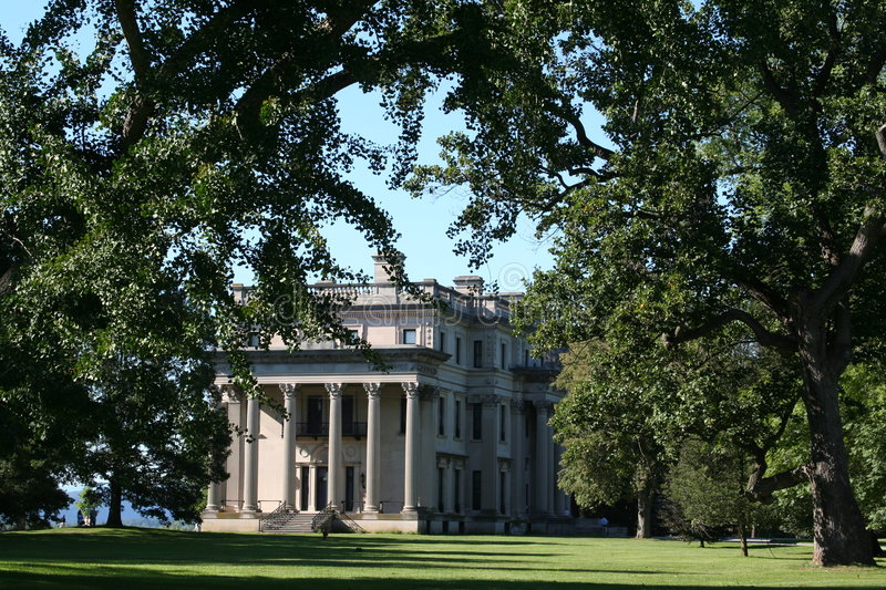 Vanderbilt Mansion. Late afternoon view of the south side the Vanderbilt Mansion in Hyde Park, NY. The main entrance on the east side is partially obstructed by royalty free stock photo