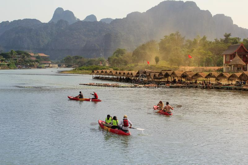 Kayaking on the Mekong River in the picturesque village of Vang Vieng royalty free stock image